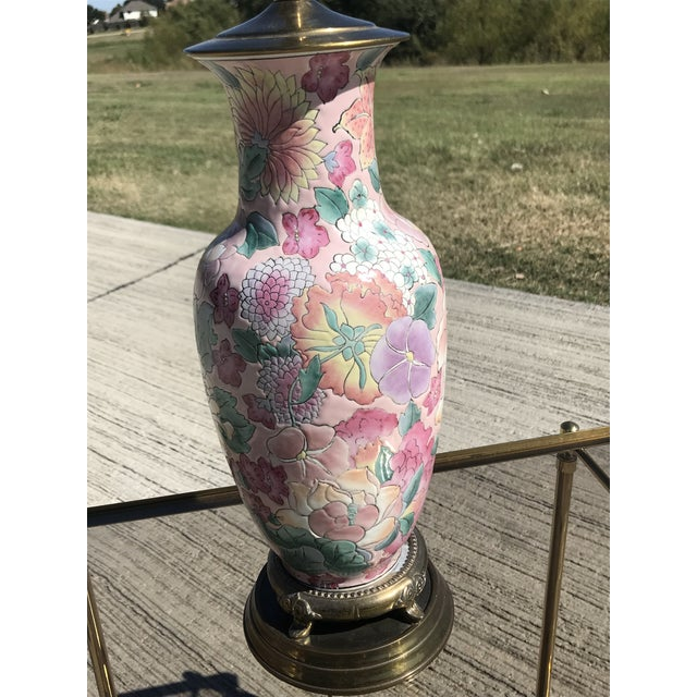 Single hand painted floral ginger jar table lamp with brass base. Beautiful floral design with pastel colors.