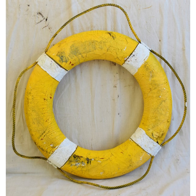 1950s nautical New England life preserver with original rope. No maker's mark. Some scuffs, wear, weathered.