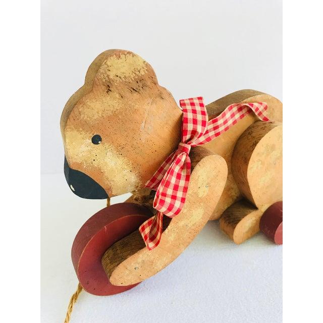 1970s Vintage Primitive Wood Teddy Bear on Rolling Wheels For Sale - Image 5 of 11