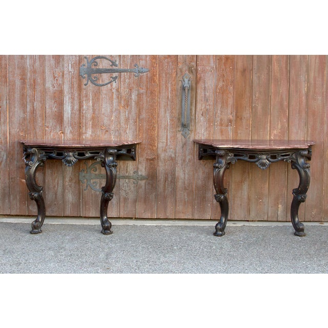 This Louis XV inspired console tables features shaped red marble top supported by a beautifully carved acanthus front...