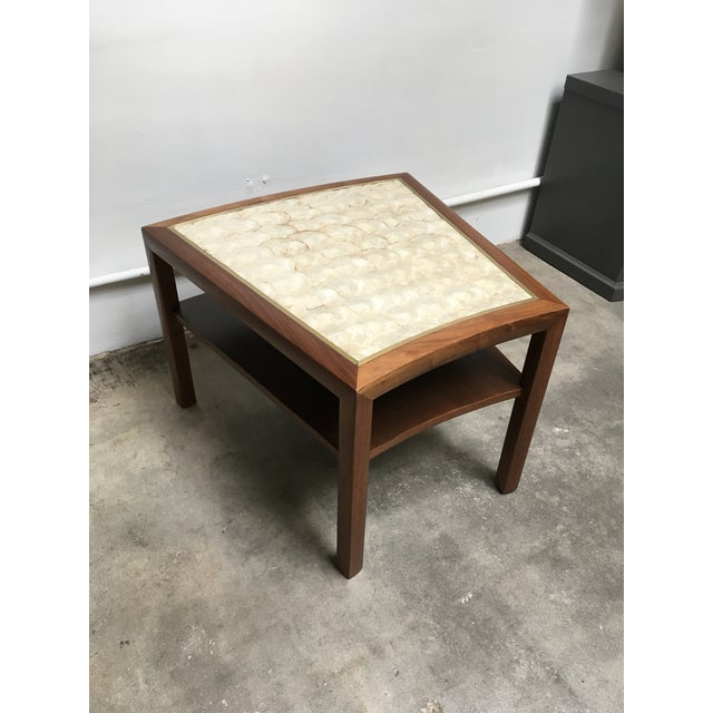 Incredible Capiz shell top side table that is likely a Dunbar piece. Amazing solid walnut frame with curved detail, brass...