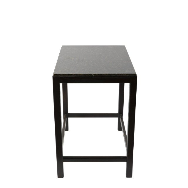 A black, marble topped side table perfect for a modern design scheme.