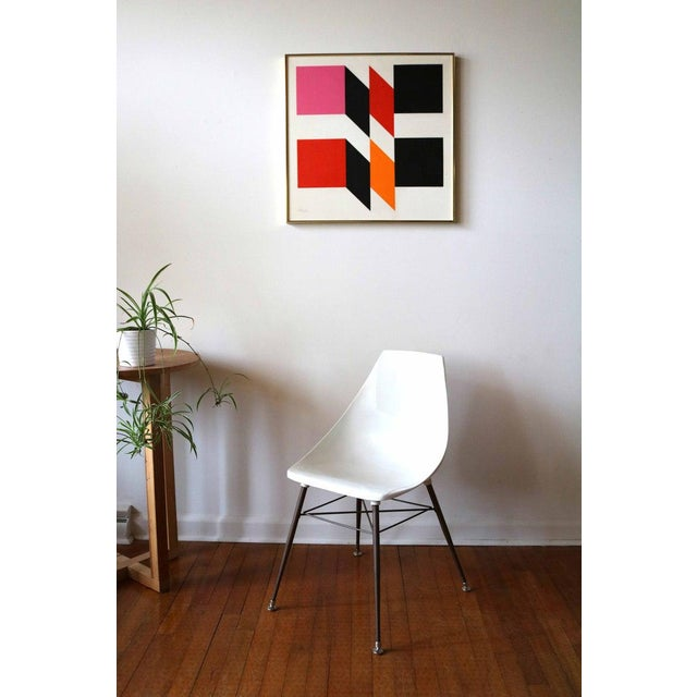 Vintage 1960's hard edge abstract oil painting by mid century artist, Carl Slaughter. This painting features pink, red,...