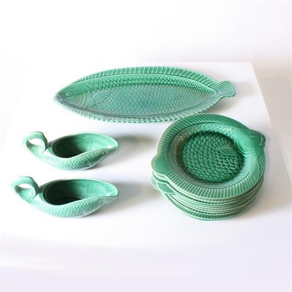 """Set of 15 green ceramic fish dishes, c. 1950. Plate: 11""""w X 9""""d X 1""""h. Tray: 21""""w X10""""d X 1 1/2""""h. Bowl: 9 1/2""""w X 31/2""""d..."""