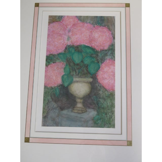 Pair gold framed signed floral prints. Made in 1992.