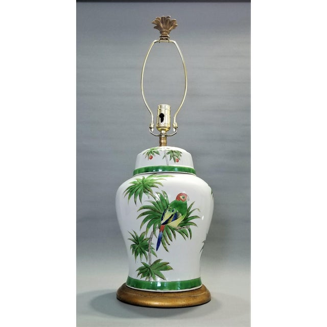 Offering a beautiful ceramic glazed Ginger Jar lamp with parrots and palm leaf folaige, circa 1990s. This lamp is...