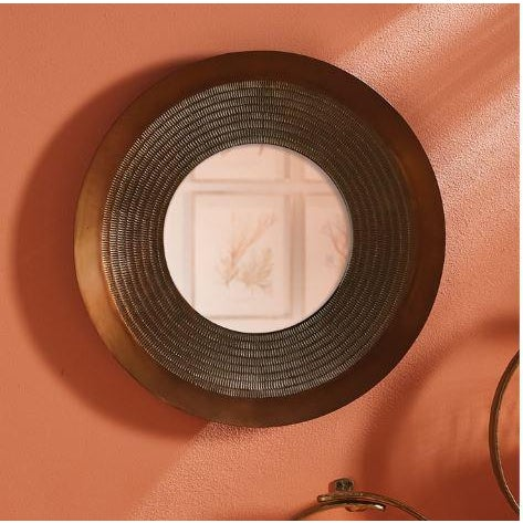 The Delane Mirror A primitive repeated carved pattern adds texture and drama to this mirror in grand scale. The hand-...