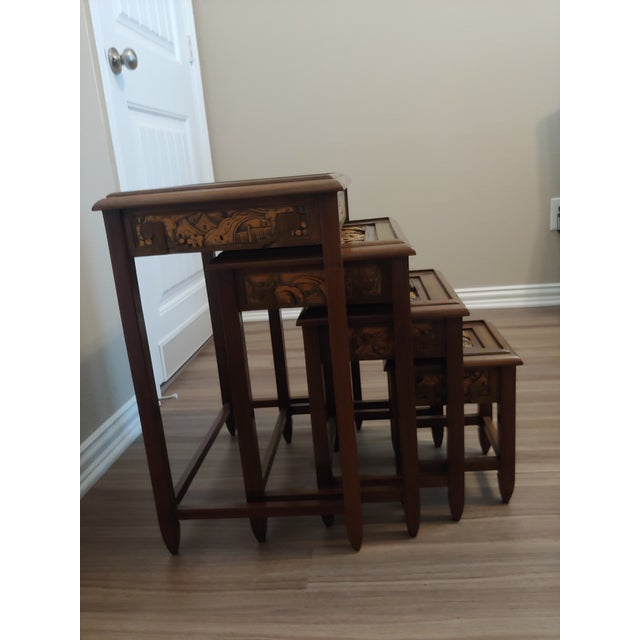 Beautiful handcrafted carved set of 4 wood nesting tables. Each table with a different countryside scene. Very minor...