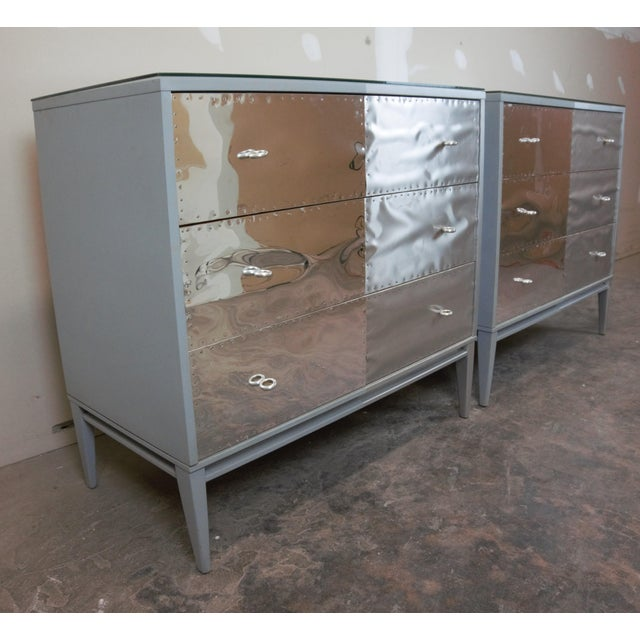 These chest have been lacquered silver and grey and given metal laminate drawer fronts along with hand done copper nails....