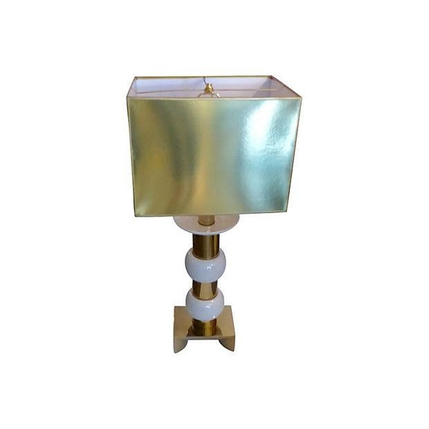 "Tall Mid-Century Modern table lamp made of brass and white ceramic. Custom shade, 16""W x 12""H x 12""D. The shade is very..."