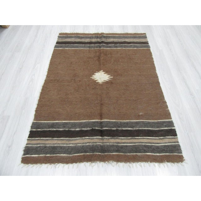 Vintage brown wool blanket kilim rug from the Siirt region of Turkey .Approximately 45-55 years old. In very good condition.