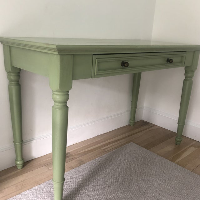 A green wooden Americana style writing desk that is perfect for a bedroom and kids.