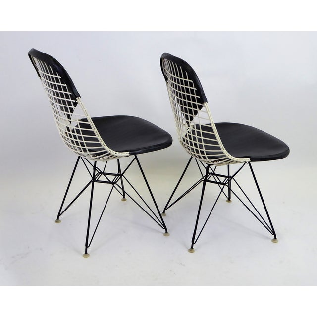 Pair of early iconic DKR chairs with black Naugahyde Bikini Pads and the Eiffel Wire Base by Charles Eames and...