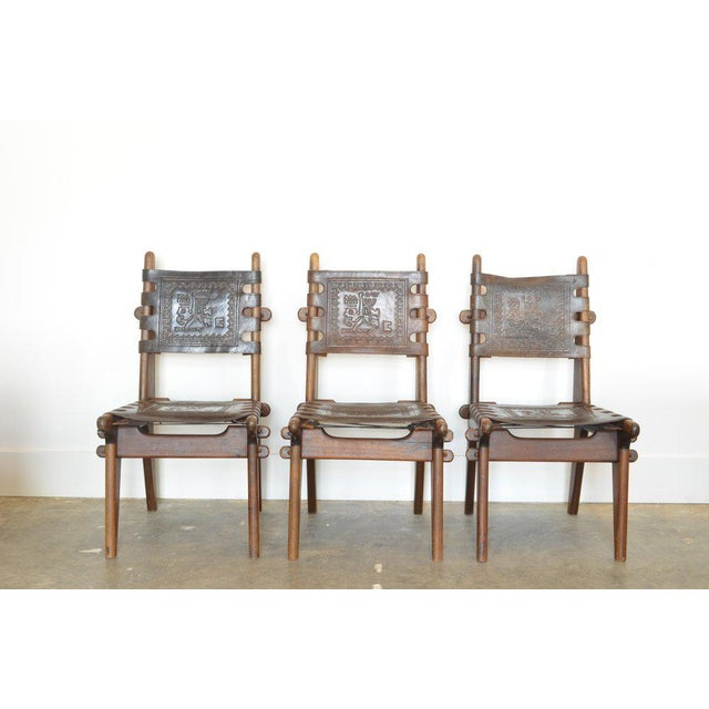 Set of six Ecuadorian Dining Chairs by Angel Pazmino, 1960's. Mfg: Muebles de Estilo. All joints are locked with wooden...