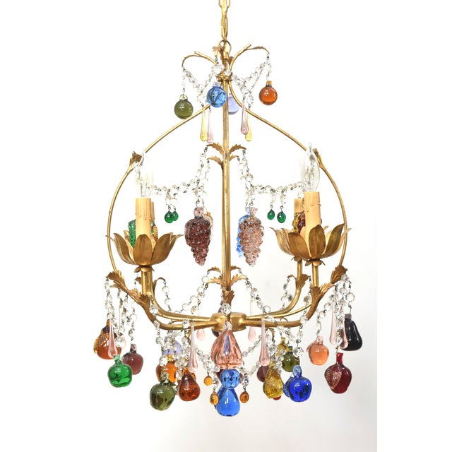 Italian fruit chandelier. Funky multicolored fruits draped over an antique gold colored frame. Four Lights. Completely...