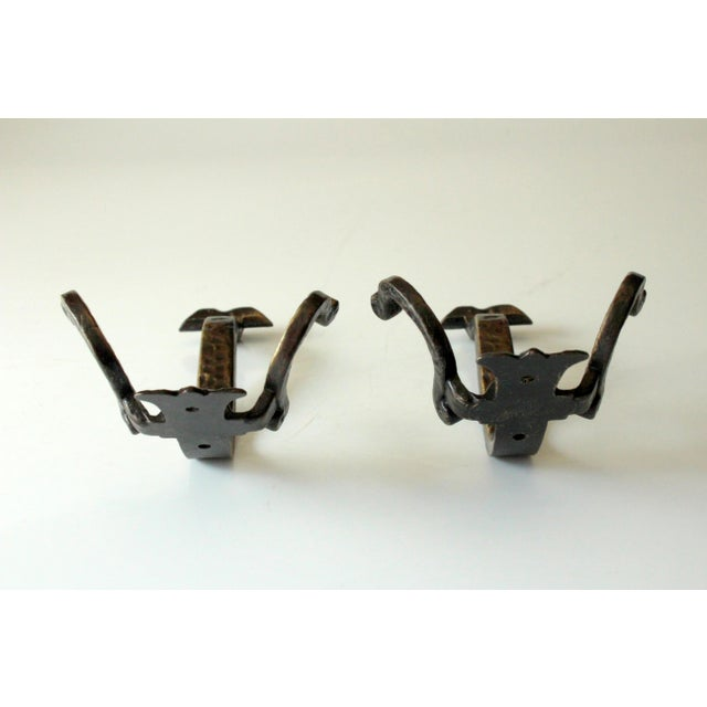 Set with 2 solid coat hooks made of wrought iron, vintage from the 1960s, front side is golden back side is black each =...