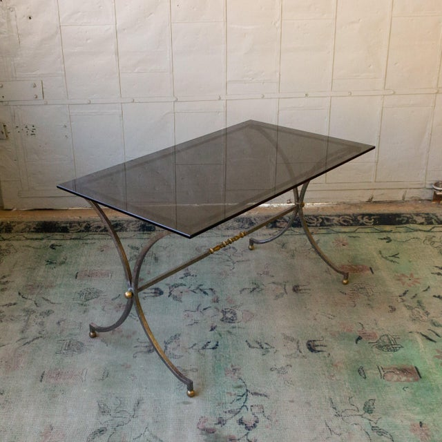 Italian brushed steel end table with brass details end table. The table as a new grey glass top, circa 1950s.