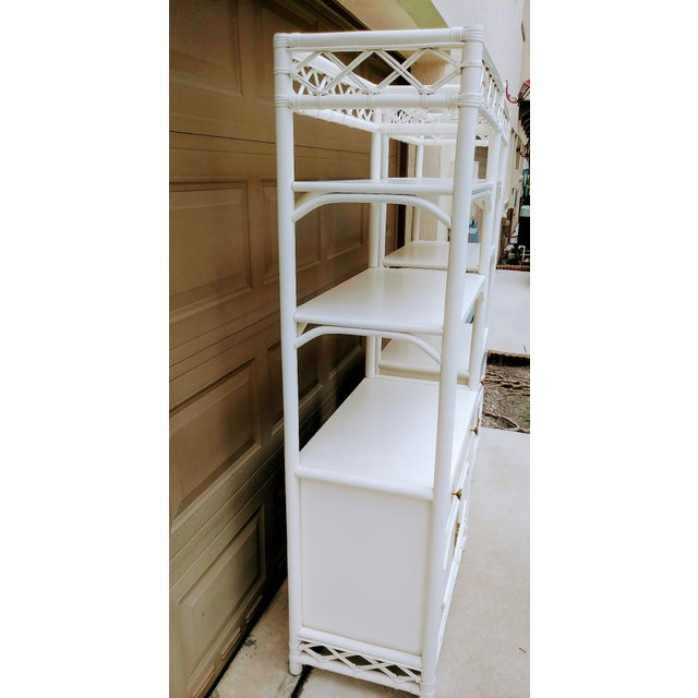 Rare Ficks Reed pair of tall white etagere cabinets. These are such fabulous etageres! They are in fantastic condition...