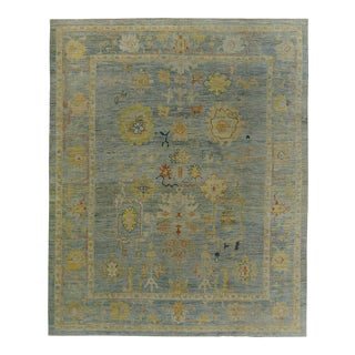 Turkish Oushak Rug With Ivory & Gold Floral Details on Blue Field For Sale
