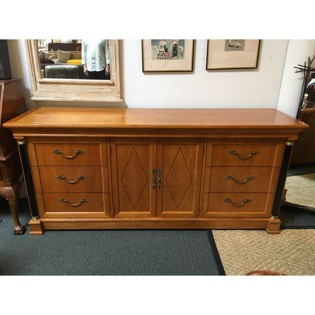 Design Plus Gallery has a Thomasville credenza. This piece has six exterior drawers as well as three interior which are...