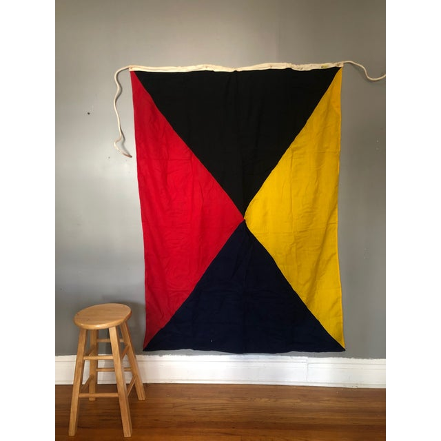 """Vintage maritime signal flag for """"Z Zulu."""" This flag, with a pop of primary colors, is part of an international maritime..."""