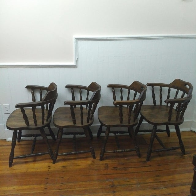 Offered are these beautiful and well preserved mid-century classic Americana barrel back captain's chairs. They hail from...