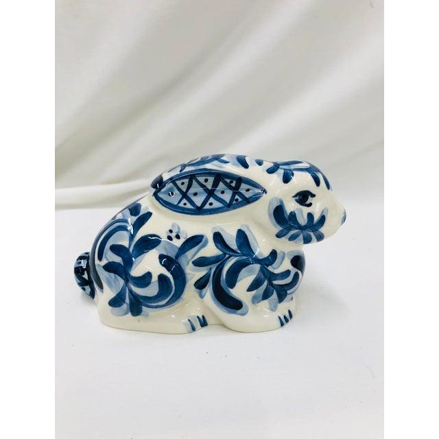 Gail Pittman hand painted blue and white rabbit.