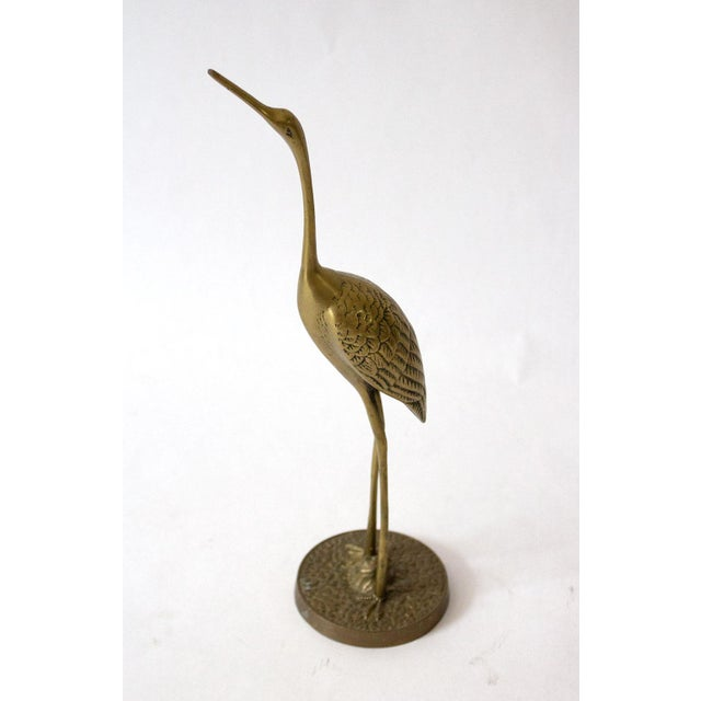 Two beautifully cast cranes: parental figures guarding their nests. Highly detailed in warm glowing brass. Left measures...