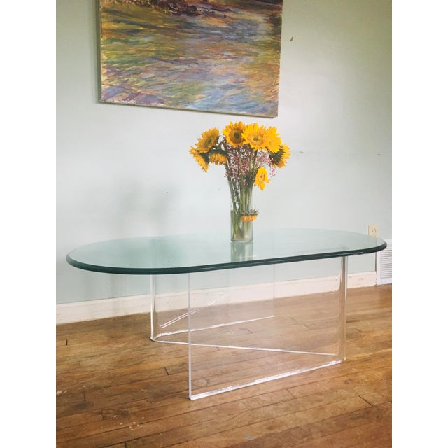 Unique lucite zig zag base coffee table with beveled glass top. Exact age unknown but estimate 1970s.