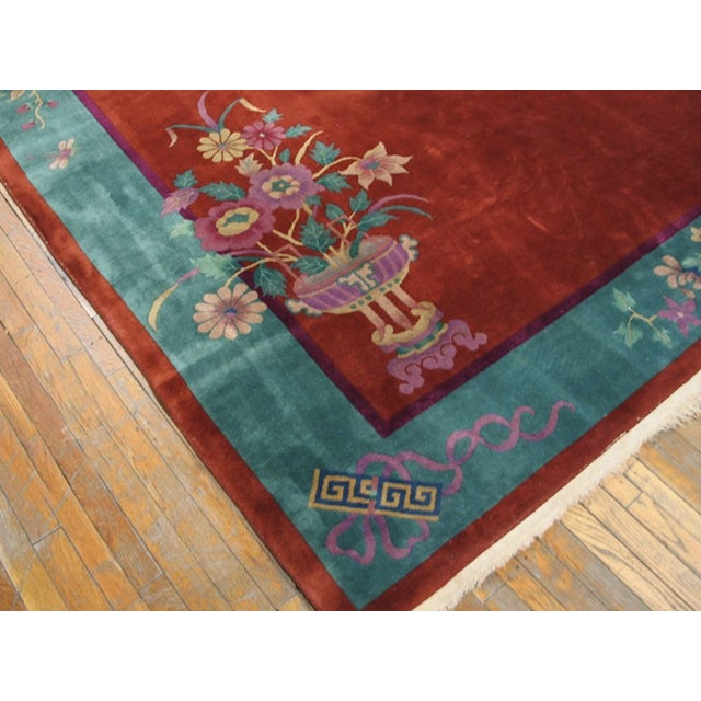 Red Chinese Art Deco Rug with a red background.