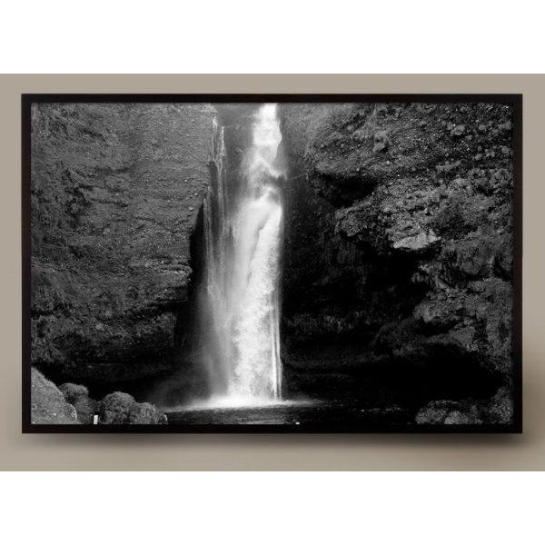 This series of Large format Black and White photographs by Jeaneen Lund capture the majesty of a massive waterfall at the...