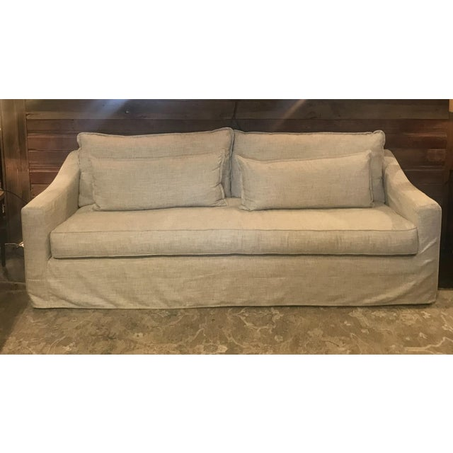 This Moss Studio slipcovered sofa is covered in an easy care 100% polyester with the look and feel of linen. Moss Studio...