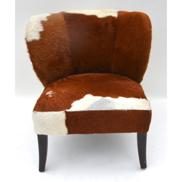 A cowhide lounge chair, simply 1950s clean lines and comfy styling, great character.