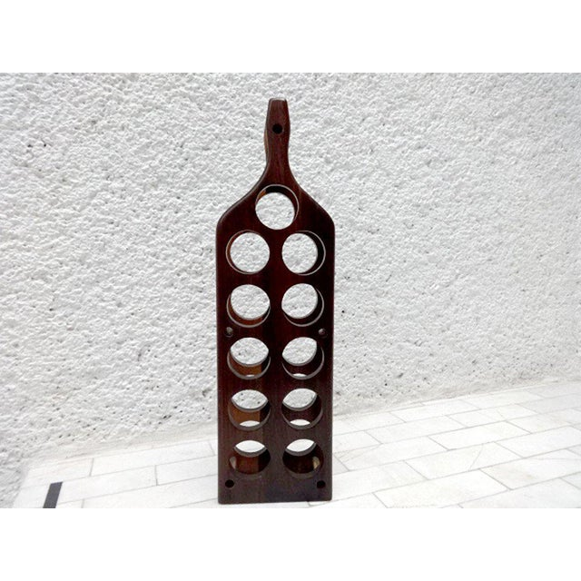 For your consideration a vintage cocobolo wine rack in the shape of a wine bottle. Rack can hold up to eleven (11)...