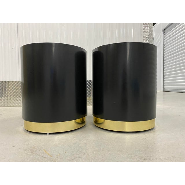 Mid-century modern cylinder shape laminated black & brass side tables or nightstands. Newly lacquered in a high gloss...