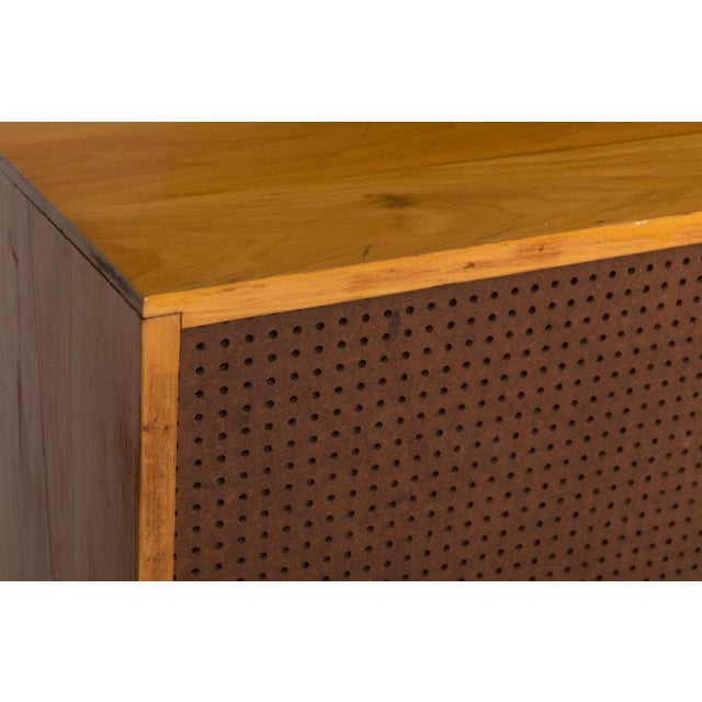 Gorgeous Paul McCobb planner group sliding door cabinet on a platform bench. The piece is made from light toned wood,...