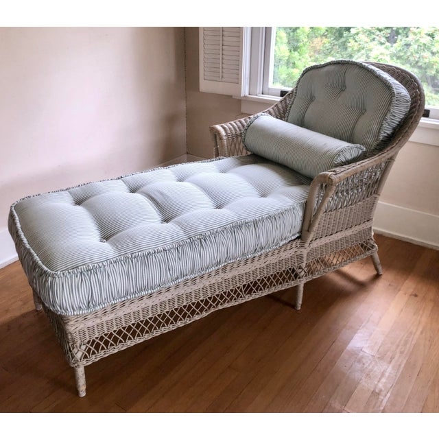 Vintage Nantucket Wicker Chaise Lounge. Includes lovely pinstriped upholstery and tufted cushions.