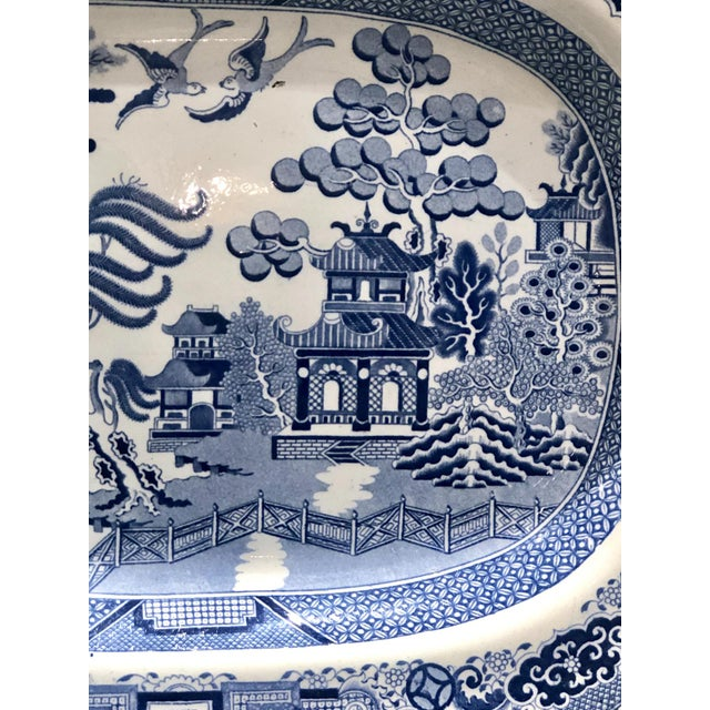 An early 19th Century English Blue Willow pattern platter, circa 1800