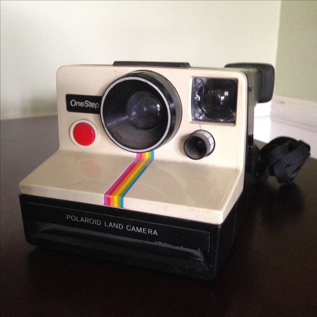 Vintage Poloroid One Step Land Camera. Great looking retro display piece featuring cream, plastic body with cool rainbow...