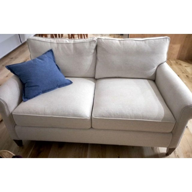 Crate & Barrel Montclair White loveseat in like-new condition. It is only 6 months and never used (did not fit in the...