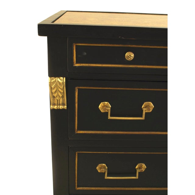 French Louis XVI style (1940s) ebonized chest with 3 bronze trimmed drawers & handles under a single narrow drawer with an...