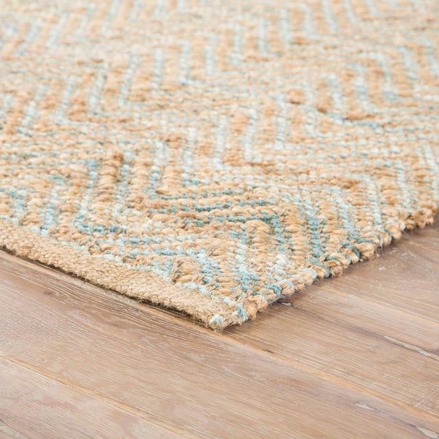 A natural area rug with a contemporary touch, this cotton-backed layer's rich tan tone and hints of pale green striated...