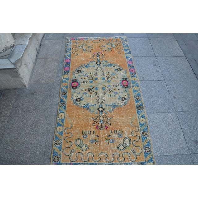 This is a vintage Turkish Oushak rug from the 1960s. The piece was hand-knotted