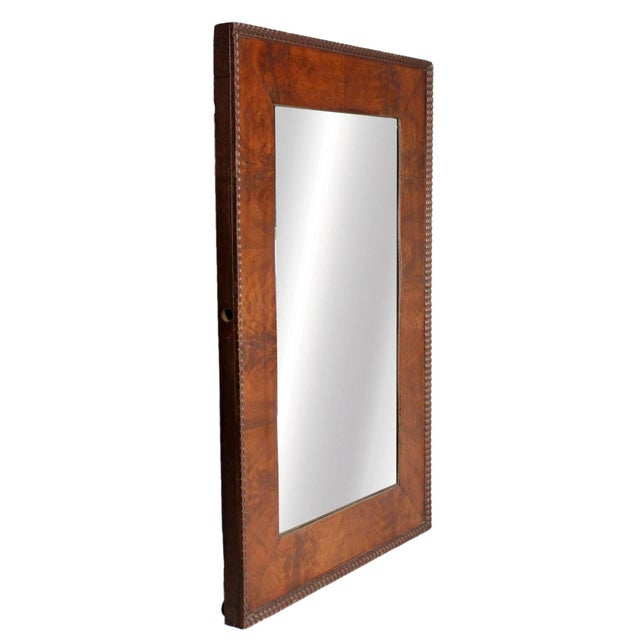 This gorgeous 1970's mirror is made of red burl wood and is highly detailed with intricate carved wooden bead like work at...