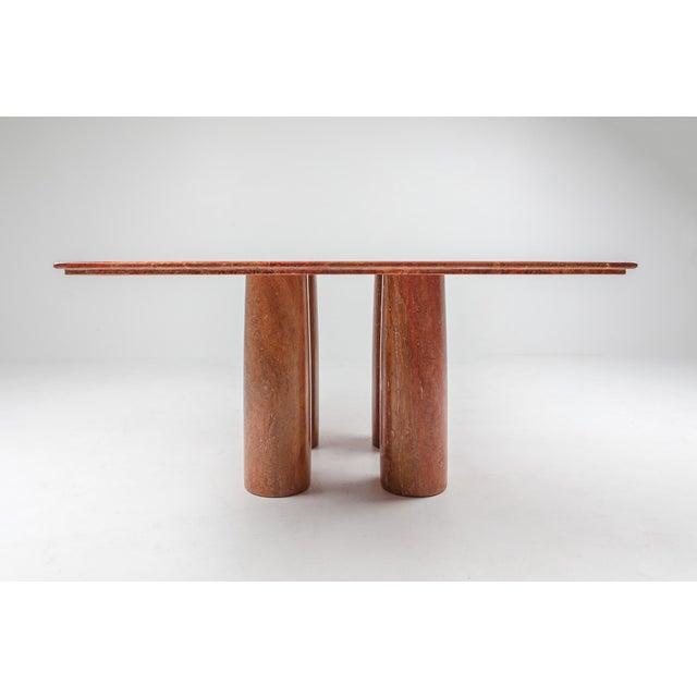 Mario Bellini for Cassina, 'Il Colonato' table, red travertine, Italy, 1970s. For this series of tables, Bellini was...