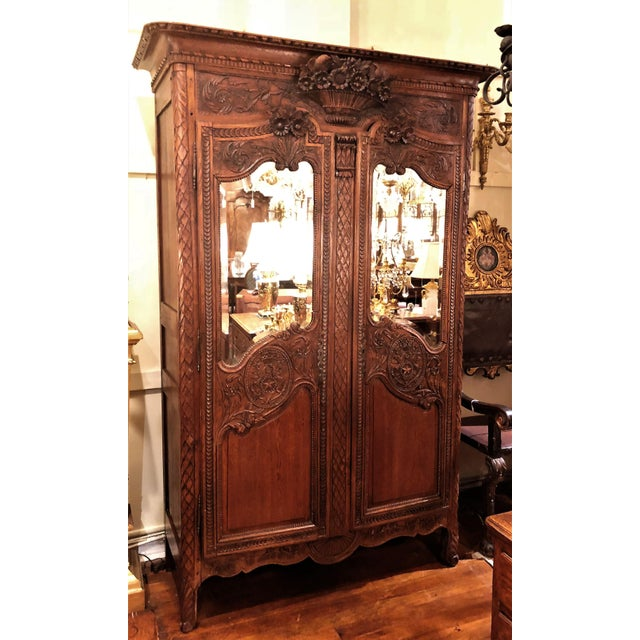 "Antique French Beautifully Carved Elm Wood and Beveled Mirror ""Armoire De Marriage"" With Bird Motifs."