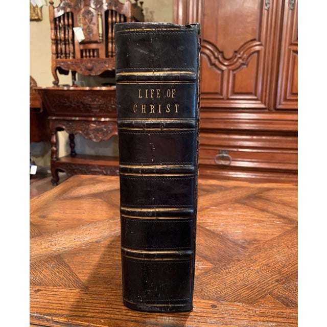 This beautiful antique black leather bound book with gilt accents was presented to Henry Bishop by his affectionate sister...
