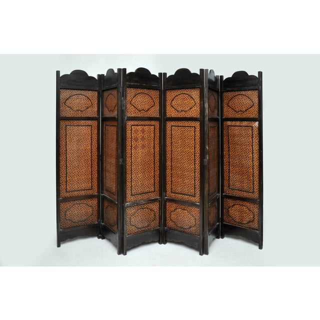 This six fold screen has a wood frame encasing pictorial panels expressed in woven designs in intricately woven bamboo...