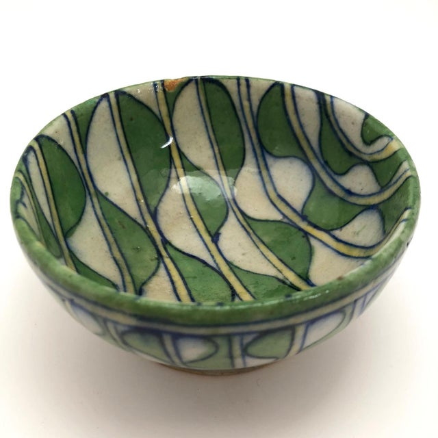 The first word that comes to mind to describe this exquisite little bowl, gorgeously made and I believe quite old, is...