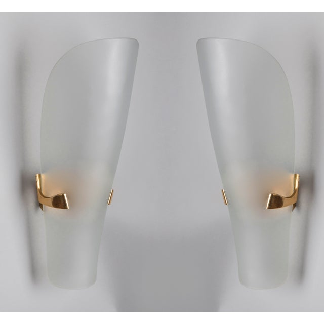 Max Ingrand (1908–1969) An elegant and elongated pair of sconces by Max Ingrand for Fontana Arte, with curved and rounded...
